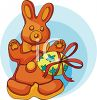 clip art illustration of a Easter bunny cookie and a colored easter egg wrapped in a bow clipart