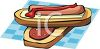 picture of a hot dog on a bun with ketchup and cheese clipart