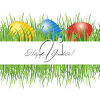 Painted eggs in grass on an easter greeting clipart