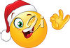 Clipart illustration of a smiling emoticon with a santa hat. clipart