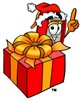 Cartoon Book Character With a Christmas Present clipart