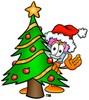 Cartoon Pencil Character Beside a Christmas Tree clipart