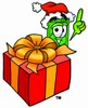 Cartoon Money Character Beside a Christmas Present clipart