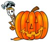 A halloween pumpkin and a hammer clipart