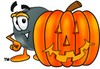 Hockey Puck Cartoon Character With a Halloween Pumpkin clipart