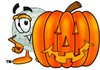 Golf Ball Cartoon Character With a Halloween Pumpkin clipart
