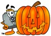Camera Cartoon Character With a Halloween Pumpkin clipart