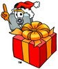 Camera Cartoon Character With a Christmas Gift clipart