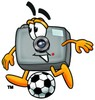 Camera Cartoon Character Playing Soccer clipart