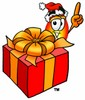 Flame Cartoon Character With a Christmas Gift clipart