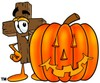 Wooden Cross Cartoon Character With a Halloween Pumpkin clipart