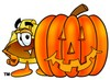 Hard Hat Cartoon Character With a Halloween Pumpkin clipart