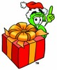 Dollar Sign Cartoon Character With a Christmas Gift clipart