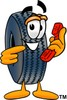 Cartoon Tire Character Holding a Telephone clipart