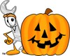 Cartoon Wrench by a Halloween Jack-o-lantern clipart