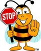 Cartoon Bumble Bee or Honey Bee Holding a Stop Sign clipart