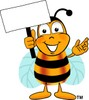 Cartoon Bumble Bee or Honey Bee Holding a Sign clipart