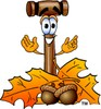 Cartoon Mallet With Autumn Leaves clipart