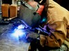 Military Metal Worker Welding a Handle. clipart