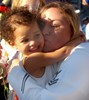 Female Sailor Hugging Her Daughter at a Homecoming Celebration in San Diego CA. clipart
