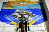 Sailors Painting a Mural of the USS Carl Vinson on the Ships Hangar Bay Doors. clipart