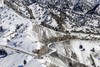 Semi-Trucks Driving on Snowy Mountain Road - K-G Pass, Afghanistan. clipart