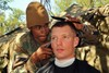 Soldier Giving Another Soldier a Haircut. clipart