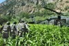 Afghan National Security Forces and American Army Soldiers Moving Through Brush Toward a Helicopter. clipart