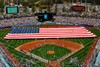 Sailors and Marines Holding a Football Field Size Flag Across Dodger Stadium. clipart