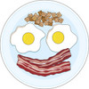 Breakfast of bacon and eggs in the shape of a smiling face clipart